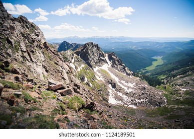 Landscape view overlooking Piney Lake and the Rocky Mountains from the summit of the Gore Range,