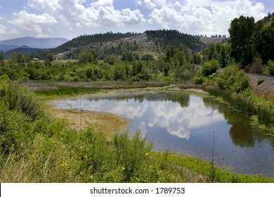 Landscape View of a Pond, Mountains and Green in Helena Montana