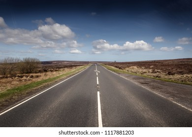 landscape view of a road cutting through england