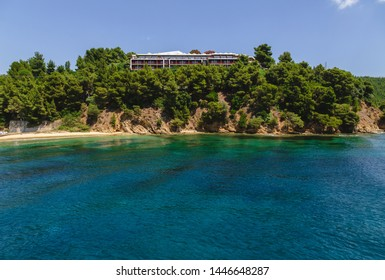 Landscape view to Skiathos island from the sea. Old bildings of town. Greece