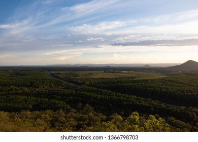 Landscape view south towards Brisbane during sunset at The Glasshouse Mountains on Queensland's Sunshine Coast, from the Wild Horse Mountain Lookout