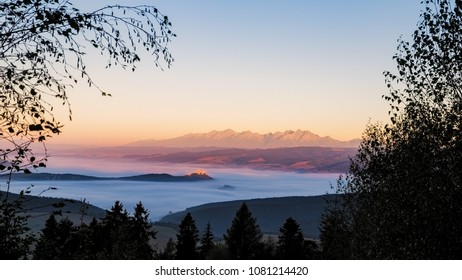 Landscape view of Spis castle and High Tatras mountains at sunrise, Slovakia, Europe