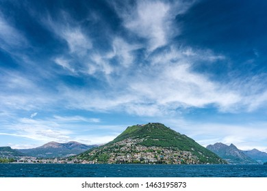 Landscape view of stunning sky and clouds above lake Lugano in Lugano, Switzerland