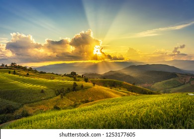 landscape view sun ray in sunset time at green terraced plantation  paddy rice field in Pa bong Pieng , Mae Chaem, Chiang Mai, Thailand