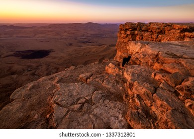 landscape view of sunrise at the desert, with clear sky sun and mountains over Mitzpe Ramon, Israel
