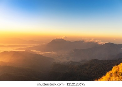 landscape view of sunrise with fog in early morning on Phu Chi Dao or Phu Chee Dao mountain at Chiang Rai, Thailand