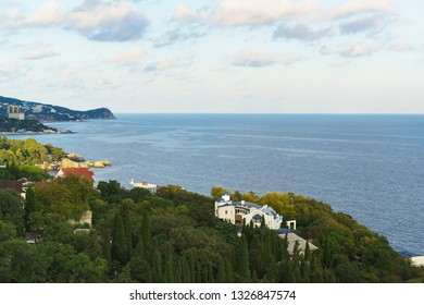 Landscape view at sunset from the observation deck to the resort village of Alupka in the Crimea. Yalta