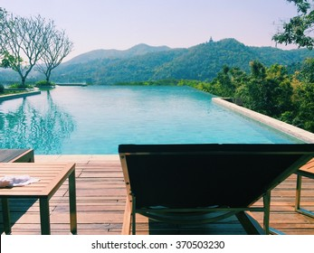 landscape view of swimming pool and top  of mountain view and nature