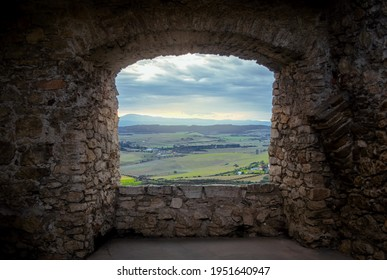 Landscape view through the window of a medieval castle.