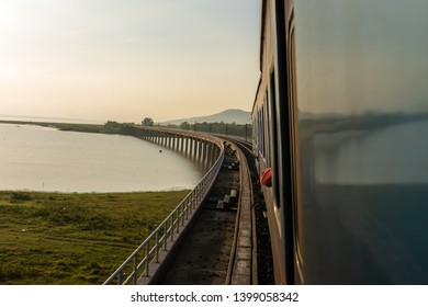 Landscape View of  Train crossing Pasak Chonlasit Dam. Reservoir for agriculture at Lopburi,Thailand