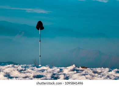 Landscape view with treking pole and winter cap during winter trelk from Nag Tibba or Serpent's summit. Nag Tibba is the highest peak in the lesser himalayan region of Garhwal, Uttarakhand, India.