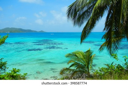Landscape view of turquoise Caribbean Sea and lush green tropical island of San Andres y Providencia, Colombia