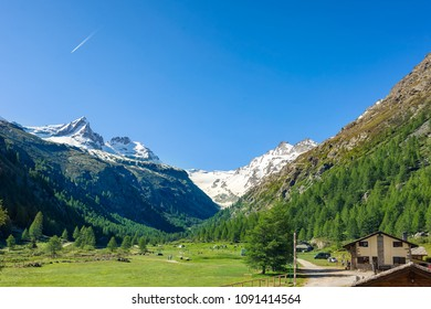 Landscape view of the valley and the snowy mountains Alps of Valsavaranche, Aosta, Italy