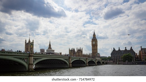 Landscape view of Westminster Bridge, Big Ben, Thames River and Houses of Parliament in London England.