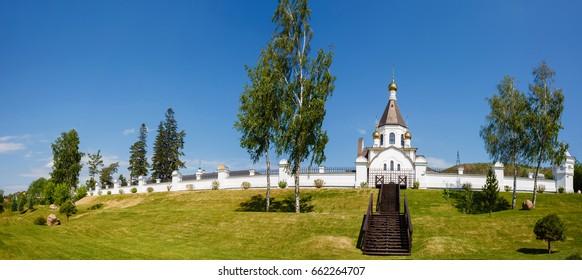 Landscape, view of the white stone monastery on the river bank Yenisei in Russia, Krasnoyarsk