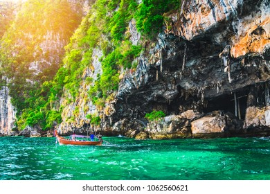 Landscape of Viking cave with longtail boat for traveler, Maya bay, Phi Phi island, Andaman sea, Krabi, near Phuket, Travel Thailand, Beautiful destination place Asia, Summer outdoor vacation trip
