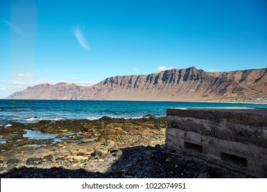 Landscape with volcanic hills and atlantic ocean in Lanzarote Island, Canaries, Spain