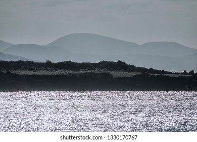 landscape of a volcanic island with a sparkling sea in bright light, lanzarote, canary islands, Spain, Europe