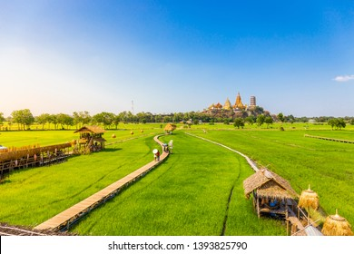 Landscape of Wat Tham Sua Temple (Tiger Cave Temple) with Jasmine rice fields at Kanchanaburi Province, Thailand. Is an important landmark that everyone must visit