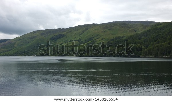 Landscape with water and mountains.