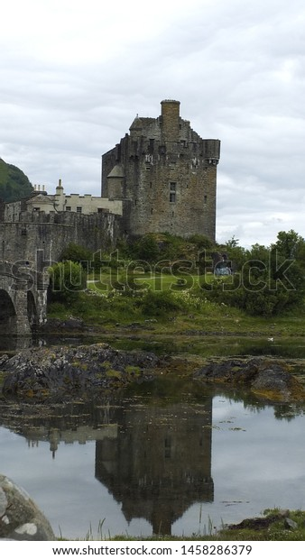 Landscape with water and old castle in the background.