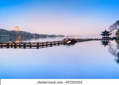 Landscape of West Lake. Long Bridge and Leifeng Pagoda. Located in Hangzhou City, Jiangsu Province, China.