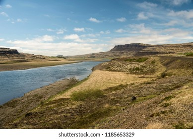 A Landscape in Western Iceland with a stream and cliffs.