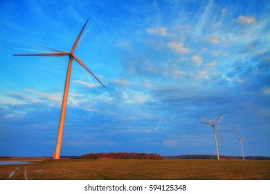 Landscape - The wind power stations in early spring field. Eastern part of Poland, Europe.