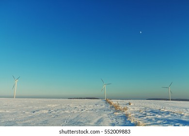 Landscape - The wind power stations in winter field. Eastern part of Poland, Europe.