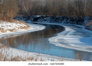 landscape of  winter river under ice