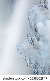 Landscape of winter waterfall framed by ice and captured with motion blur, Comstock Creek Cascade, Michigan, USA