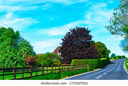 Landscape without Cars in empty road in England UK. Vacation trip on highway with nature. Scenery with drive on Holiday journey for recreation. Motion ride in Europe. No Transport
