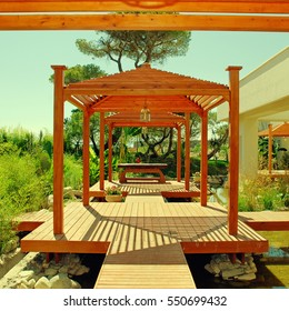 Landscape with wood pavilion, deck and tropical plants in summer resort, square toned image