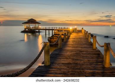 Landscape of Wooded bridge pier between sunset. Summer travel in Phuket ,Thailand.