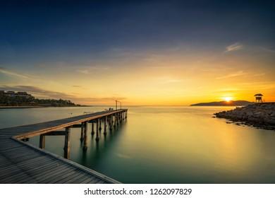 Landscape of Wooded bridge in the port between sunrise - Shutterstock ID 1262097829