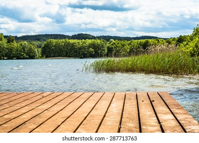 Landscape of wooden pier over beautiful lake in the summer. Vacation and holiday time, nature composition or postcard. - Shutterstock ID 287713763
