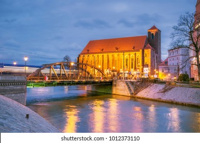 Landscape of Wroclaw at night with bridges and Church of the Blessed Virgin Mary on the Sand in Wroclaw, Poland