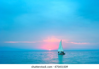Landscape with a yacht at sunset in the sea