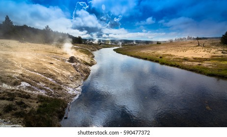 landscape of Yellowstone National Park. The river in Yellowstone National Park is fuming and smokey due to the thermal activity under the it.