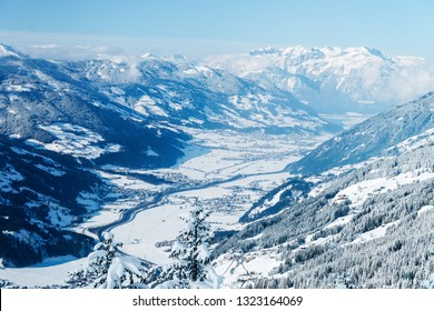Landscape in Zillertal Arena ski resort in Zillertal in Tyrol. Mayrhofen in Austria in winter in Alps. Alpine mountains with snow. Downhill fun. Blue sky and white slopes at Zell am Ziller.