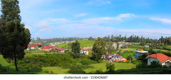 The landscaped beauty of Ooty where the green earth meets the radiant blues of the sky