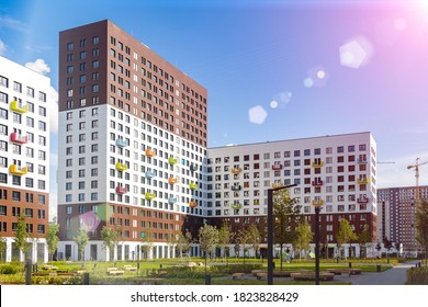 Landscaped courtyard in residential complex. Modern apartments. High-rise buildings