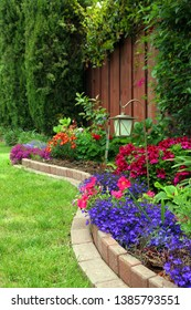 Landscaped garden made of bricks in curved shape