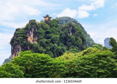 Landscapes of the Chinese province of Guangxi. Traditional building in oriental style on the observation platform of the western mountain of Yangshuo Park
