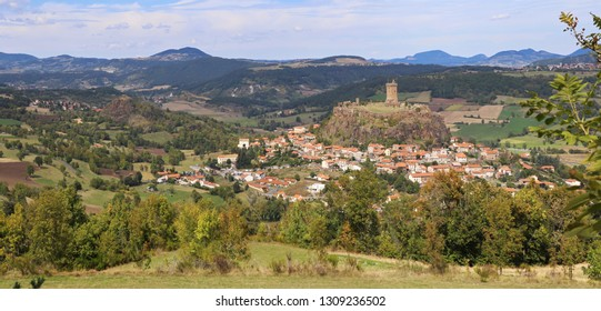 Landscapes of France. Region Auvergne. Panorama of the medieval fortress and the village