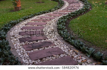 Landscaping In The Green Garden. Pathway In Park,curve Walkway With Stone  Tile On