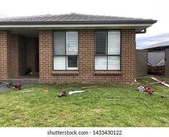 Landscaping house grass windows bricks tools roof