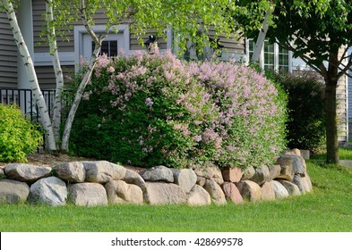 Landscaping and Rock Retaining Wall at a Residential Home
