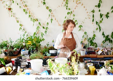 Landscaping. The woman is a professional botanist, the florist grows plants
