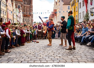 Landshut,Germany-April 15,2017:A juggler  tosses pins in  the air during a show at the Landshut Wedding festival